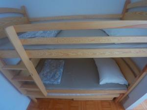 A bunk bed or bunk beds in a room at Lotus apartment