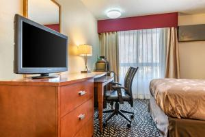 A television and/or entertainment center at Quality Inn Falconer - Jamestown