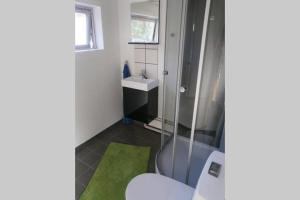 A bathroom at Lofoten Apartment + Rooms - Skrova