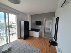 A television and/or entertainment center at Valentinos Apartments