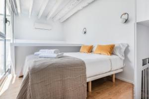 Cama o camas de una habitación en Slow Suites Maestranza