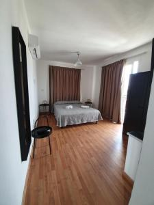 A bed or beds in a room at Valentinos Apartments