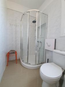 A bathroom at Valentinos Apartments