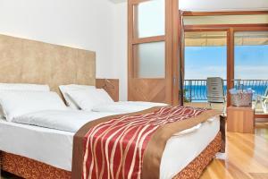Postel nebo postele na pokoji v ubytování Hotel Baia Verde