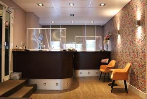 The lobby or reception area at Aadam Hotel Wilhelmina