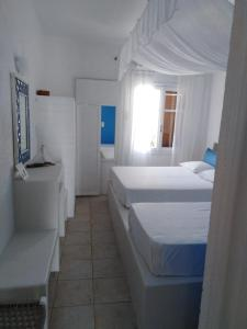 A bed or beds in a room at Villa Marilena
