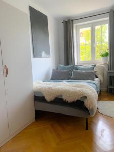 A bed or beds in a room at Apartament Grunwaldzka
