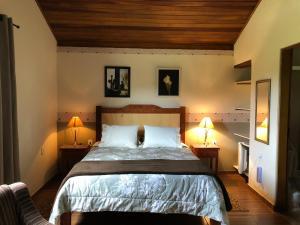 Cama ou camas em um quarto em Pousada Vale dos Sonhos