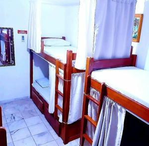 A bunk bed or bunk beds in a room at Hostel da 13 e Suítes