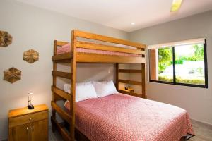A bunk bed or bunk beds in a room at Recent remodeled 2-bedroom beachfront condo