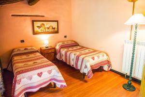 Een bed of bedden in een kamer bij A Casa Del Tosi