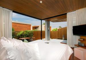A bed or beds in a room at Casa De La Flora