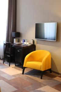 A television and/or entertainment center at Dada Boutique Home Hotel
