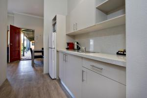 A kitchen or kitchenette at Vintages Accommodation