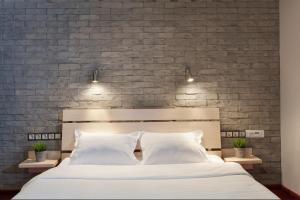 Ein Bett oder Betten in einem Zimmer der Unterkunft Marins Park Hotel Novosibirsk
