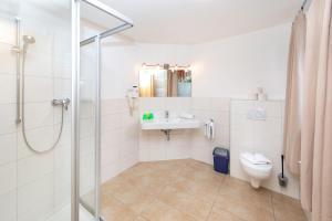 Ein Badezimmer in der Unterkunft Elto Appartements
