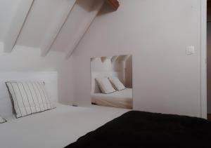 Un ou plusieurs lits dans un hébergement de l'établissement Gîte de l'Étang