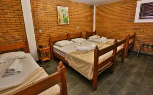 Cama ou camas em um quarto em Hotel Fazenda Campo dos Sonhos