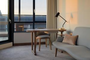 A seating area at Mövenpick Hotel The Hague ''opened 1st of June 2020''
