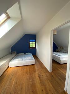 Łóżko lub łóżka w pokoju w obiekcie Dom wakacyjny Wrota Mazur