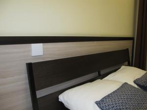 A bed or beds in a room at Largus Hotel