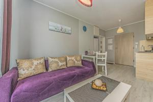 A seating area at Apartament LUX