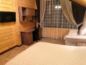 A bed or beds in a room at Усадьба Горный Алтай