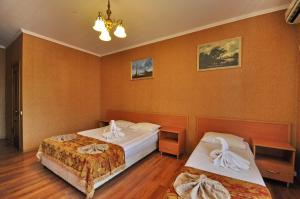 A bed or beds in a room at Bretan Guest House