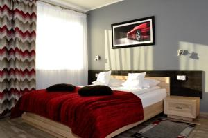 A bed or beds in a room at Comfort-24
