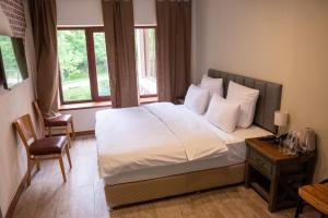 A bed or beds in a room at Apricot Aghveran Resort