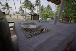 A restaurant or other place to eat at Marari Praise Beach Front Homestay
