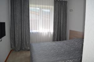 A bed or beds in a room at Гостевой дом Пять холмов
