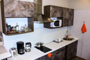 Küche/Küchenzeile in der Unterkunft RABISON