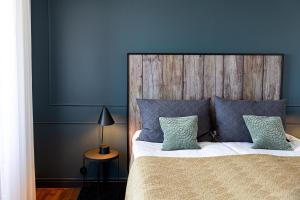 Säng eller sängar i ett rum på Varbergs Kusthotell