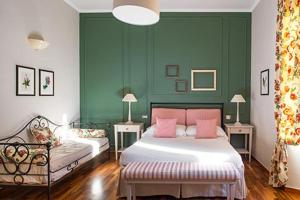 A bed or beds in a room at San Giovanni Terme Rapolano