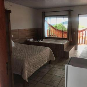 Cama o camas de una habitación en Pousada Estrela Guia