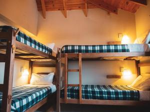 A bunk bed or bunk beds in a room at America Del Sur Calafate Hostel