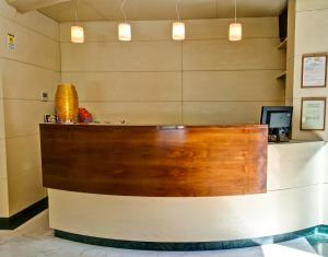 The lobby or reception area at Crosti Hotel