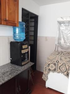 A kitchen or kitchenette at Residencial Morada do Sol