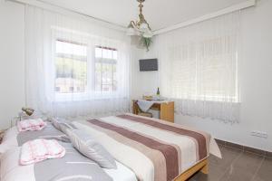 Postel nebo postele na pokoji v ubytování Penzion U Králíků