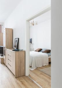 Postel nebo postele na pokoji v ubytování Apartament Poznańska