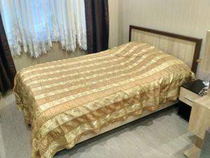Кровать или кровати в номере Apartament Anapskaya 25