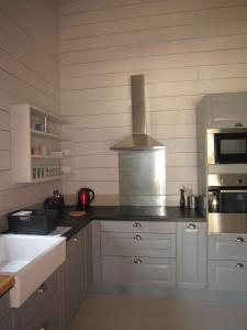 A kitchen or kitchenette at Les Cabanes de Carelle