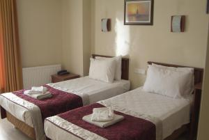 A bed or beds in a room at Kafkas Hotel Istanbul