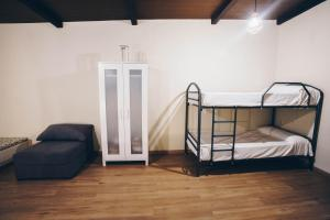A bunk bed or bunk beds in a room at Complejo Roma