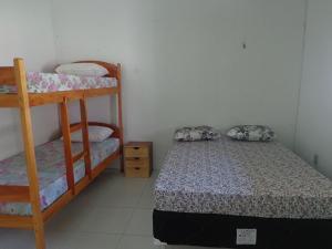 A bunk bed or bunk beds in a room at Casa na Praia de Atalaia