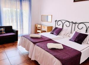 A bed or beds in a room at Villa Pelae