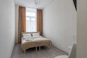 Кровать или кровати в номере Отель Династия на Белорусской