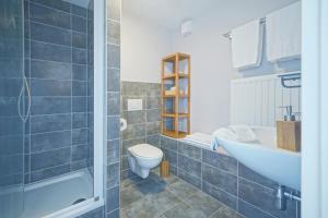 A bathroom at B&B Maison Ruthier