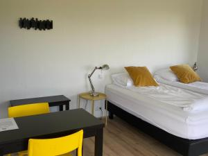 A bed or beds in a room at Brú Guesthouse